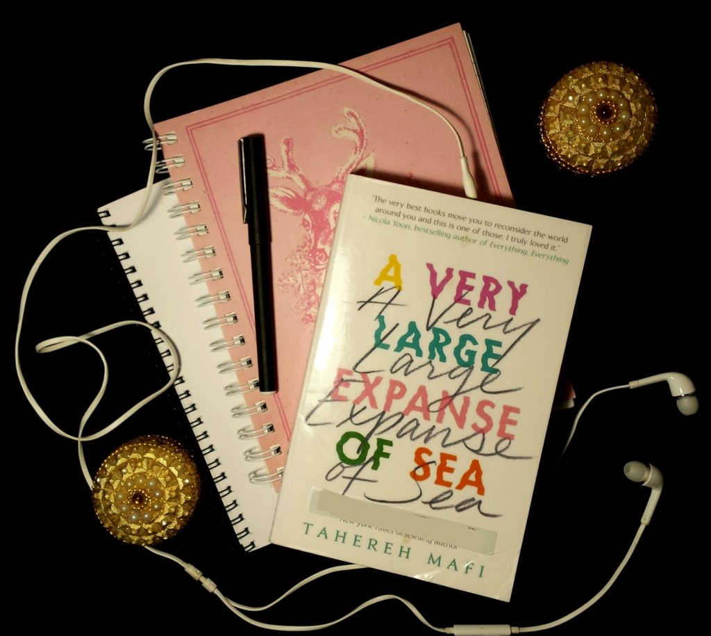 Tahereh Mafi's A Very Large Expanse of Sea book flatlay.